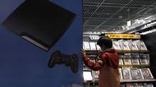 A boy chooses Sony's Playstation game software at an electronic shop in Tokyo May 5, 2011. Sony Corp blamed Internet vigilante group Anonymous for indirectly allowing a hacker to gain access to personal data of more than 100 million video game users. (KIM KYUNG-HOON/REUTERS)