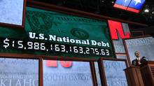 A U.S. national debt clock serves as the backdrop for the Republican National Convention in August. (© Shannon Stapleton / Reuters/REUTERS)
