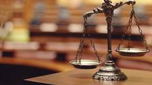 """""""Symbol of law and justice in the empty courtroom, law and justice concept."""" (Vladek/Getty Images/iStockphoto)"""