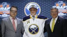 Sam Reinhart stands with Buffalo Sabres officials after being chosen second overall during the first round of the NHL hockey draft, Friday, June 27, 2014, in Philadelphia. (Matt Slocum/AP)