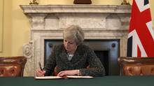British Prime Minister Theresa May has signed a letter to the European Union officially notifying it of the U.K.'s intention to leave the bloc. (Reuters)