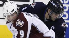 Colorado Avalanche's Matt Duchene (9) puts a hard check into Winnipeg Jets' Andrew Ladd (16) during second period NHL hockey action in Winnipeg, Sunday, February 19, 2012. The Jets won 5-1. THE CANADIAN PRESS/Trevor Hagan (Trevor Hagan/CP)