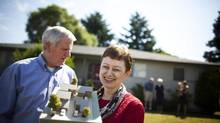 John Higgins(left) and Kathleen Higgins(middle) are photographed holding a model of their plans for future housing outside their home in Delta, British Columbia, Monday, July 01, 2013. Rafal Gerszak for The Globe and Mail (Rafal Gerszak For The Globe and Mail)