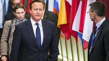 """British Prime Minister David Cameron leaves the EU Council building at the end of an EU summit in Brussels, early Sunday, Aug. 31, 2014. In a letter to North Atlantic Treaty Organization leaders last month, Prime Minister Cameron called the issue a """"personal priority"""" and said he would like to see other countries sign on to a charter that could be modelled on Britain's own Armed Forces Covenant. (Geert Vanden Wijngaert/AP)"""