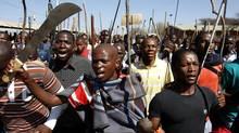 Striking mine workers take part in a march at Lonmin's Marikana mine in South Africa's North West Province September 10, 2012. (SIPHIWE SIBEKO/REUTERS)