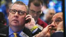 Traders wait for the opening price of Santander Consumer USA Holdings Inc., during the company's IPO on the floor of the New York Stock Exchange, shortly after the opening bell in the Manhattan borough of New York January 23, 2014. (LUCAS JACKSON/REUTERS)