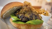 The Kobe Burger ($21), topped with Guiness cheddar, caramelized onions, truffle aioli at the Stackhouse Burger Bar in Vancouver April 13, 2011. (JOHN LEHMANN/THE GLOBE AND MAIL)