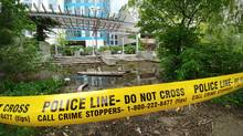 Police tape cordons off a boardwalk between a condo building and Lake Ontario. Toronto Hydro says 10 condos and two houses have been affected by rising water. (Kenny Sharpe/The Globe and Mail)