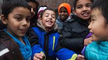 Seven-year-old Taki Alaid, centre, came to Toronto from Syria by way of Jordan. He now attends Rose Avenue Junior Public School. (Jennifer Roberts for The Globe and Mail)