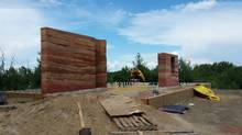 Homeowners Lance Olson and Wendy Wright are building their cottage, Pelican Perch, along with the Southern Alberta Institute of Technology to be a model for green building. Two complete rammed earth walls, made by compressing dirt, stand ready. Both rammed earth interior walls complete. (SAIT GBT)