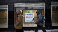A 'now hiring' sign hangs in a storefront window in downtown Thunder Bay, Dec 19, 2012. In Friday's employment figures, it's expected that the U.S. will show far more resilience than Canada. (Moe Doiron/The Globe and Mail)