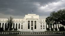 The U.S. Federal Reserve building in Washington. Analysts are almost uniform in their view that the Fed's policy committee will change little at the end of a two-day meeting today. (JIM BOURG/REUTERS)