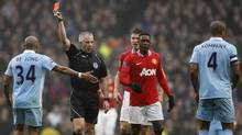 Manchester City's Vincent Kompany is shown a red card by referee Chris Foy during their FA Cup soccer match against Manchester United at the Etihad Stadium in Manchester, northern England, January 8, 2012. (PHIL NOBLE/Reuters)