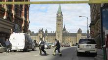 Police secure the scene of a shooting on Parliament Hill in Ottawa on Wednesday Oct.22, 2014. (Adrian Wyld/THE CANADIAN PRESS)
