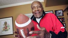Ezzrett Anderson Jr., in his Calgary home in 2005, said his fondest memory was returning to Calgary after losing the 1949 Grey Cup in Toronto and seeing 60,000 fans gathered at the train station to welcome the team home. (Todd Korol/The Globe and Mail)