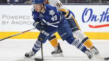 Maple Leafs' Brendan Leipsic, left, controls the puck against Ryan Johansen of the Nashville Predators in Toronto on Feb. 23. (Claus Andersen/Getty Images)