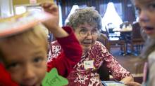 Students from Eileen Madson Primary read to Kay Maras at Columbia Garden Village in Invermere, B.C. (JOHN LEHMANN/THE GLOBE AND MAIL/JOHN LEHMANN/THE GLOBE AND MAIL)