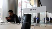 Investors have driven Apple's share price as low as $382, prompting a gaggle of analysts to pronounce it a terrific buying opportunity. (Kim Kyung Hoon/REUTERS)