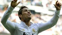 Real Madrid's Portuguese forward Cristiano Ronaldo celebrates after scoring during the Spanish league football match Real Madrid against Osasunaa at the Santiago Bernabeu stadium in Madrid, on November 6, 2011. Getty Images/DOMINIQUE FAGET (DOMINIQUE FAGET/Getty Images)