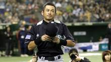 Seattle Mariners outfielder Ichiro Suzuki greets spectators during the opening ceremony of an exhibition baseball game against Japan's Hanshin Tigers at the Tokyo Dome in Tokyo Sunday. (Koji Sasahara/Copyright: AP)