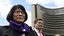 Mayoral contenders Olivia Chow, left, and John Tory are shown at a City Hall ceremony marking International Day Against Homophobia and Transphobia, May 16, 2014. Ms. Chow took aim at Mr. Tory's transit plans at the East York Rotary Club. Aug. 7, 2014. (Fred Lum/The Globe and Mail)