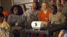 Actor Taylor Schilling, second from right, in a scene from the new Netflix series Orange is the New Black. (JESSICA MIGLIO/NYT)