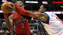 Toronto Raptors forward James Johnson has the ball slapped by Philadelphia 76ers forward Andre Iguodala during the first quarter of their NBA basketball game in Philadelphia. (TIM SHAFFER/Reuters)