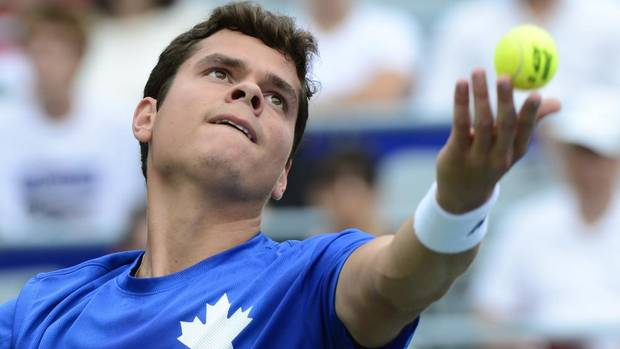 Canada's Milos Raonic serves to Latvia's Ernests Gulbis at the Rogers Cup tennis tournament Friday August 9, 2013 in Montreal. (PAUL CHIASSON/THE CANADIAN PRESS)