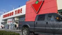Customers arrive at the Canadian Tire store in North Vancouver in this file photo. Among the most notable Canadian IPOs in the fourth quarter were Canadian Tire's real estate spinoff. (Andy Clark/Reuters)