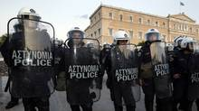 Police stand guard in front of Greece's parliament during a rally against austerity measures in Athens April 27 (YIORGOS KARAHALIS)