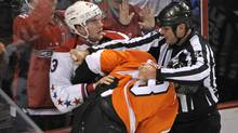 Washington Capitals right wing Tom Wilson (43) fights Philadelphia Flyers defenseman Nicklas Grossmann (8) during the second period at Wells Fargo Center. Wilson received a game misconduct on the play preceding the fight. (Eric Hartline/USA Today Sports)