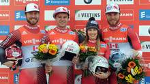 From left, Tristan Walker, Justin Snith, Arianne Jones and Mitchel Malyk of Canada celebrate their victory after the team competition at the luge World Cup in Germany, Sunday, Feb. 21, 2016. (Caroline Seidel/AP)
