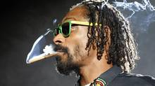 Snoop Dogg smokes while performing at the 2012 Coachella Valley Music and Arts Festival in Indio, California April 15, 2012. The Coachella festival, which commenced in 1999 on the desert lawns of the Empire Polo Club in Indio, California, has grown from 25,000 attendees overall to 75,000 people a day, and has become an important platform for alternative rock, rave and electronic music acts. REUTERS/David McNew (UNITED STATES - Tags: ENTERTAINMENT) TEMPLATE OUT (DAVID MCNEW/REUTERS)