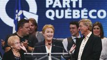 Premier Pauline Marois and her party are abandoning a popular initiative to repeal a $200 health tax. (CHRISTINNE MUSCHI/REUTERS)
