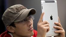 A smaller iPad may be coming, but Microsoft's Windows 8 is a bigger bet on mobile tech. (Andy Wong/The Associated Press)