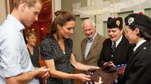 Ottawa bagpiper Madeleine Thompson gives the Duke and Duchess of Cambridge a waistcoat and fascinator adorned with the Maple Leaf tartan during the royal couple's visit to Canada in the summer of 2011. (PMO)