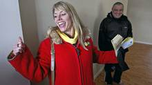 Alberta Party candidate Sue Huff cheers after Ron Picachy says she has his vote, while out door knocking in her Edmonton-Glenora riding. (Jason Franson/The Globe and Mail/Jason Franson/The Globe and Mail)