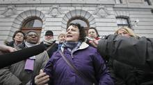 """President of the Federation des Femmes du Quebec Alexa Conradi, flanked with members of women group """"Collectif 8 mars"""", answers questions after meeting with Quebec Premier Pauline Marois in Quebec City Thursday March 7, 2013. (for The Globe and Mail/Francis Vachon)"""