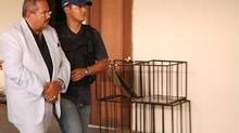 Arthur Porter (left) was arrested in Panama on Monday May 27, 2013. (Interpol)