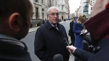 Union Cycliste Internationale (UCI) President Pat McQuaid speaks to reporters as he leaves a procedural hearing in London (SUZANNE PLUNKETT/REUTERS)