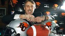 Former star B.C. Lions kicker Lui Passaglia shows off his Grey Cup rings during a news conference in Vancouver on Tuesday Dec. 18, 2001. (Mark van Manen/CP)