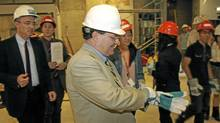 Finance Minister Jim Flaherty tours the Art Gallery of Ontario's Weston Family Learning Centre, a construction project backed by stimulus cash. (Fernando Morales/The Globe and Mail)