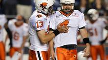 BC Lions' Paul McCallum (R) celebrates his game-winning field goal against the Winnipeg Blue Bombers with team mate Mike Reilly during the second half of their CFL game in Winnipeg, August 24, 2012. (FRED GREENSLADE/REUTERS)