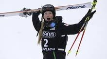 Canada's Justine Dufour-Lapointe celebrates her win in the women's freestyle World Cup moguls evenn Wednesday, Jan. 15, 2014, in Wilmington, N.Y. (Mike Groll/AP)