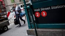 A pedestrian walks past the Wall Street subway station near New York Stock Exchange (NYSE) in New York on Friday, May 27. (Michael Nagle/Bloomberg)