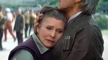 Carrie Fisher is seen with Harrison Ford in 2015's Star Wars: The Force Awakens. Disney had a $50-million (U.S.) insurance policy on Fisher, who died last month, but what the claim will be used for remains a mystery.