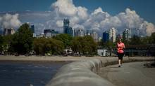 A woman jogs along the seawall near where it ends west of Kitsilano Beach in Vancouver, B.C., on Thursday May 16, 2013. (DARRYL DYCK FOR THE GLOBE AND MAIL)