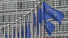EU flags fly at the European Commission headquarters in Brussels. (Yves Logghe/Associated Press)