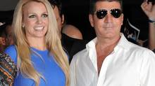 """Britney Spears and Simon Cowell attend """"The X Factor"""" season two premiere at Grauman's Chinese Theatre on Tuesday, Sept. 11, 2012, in Los Angeles. (Jordan Strauss/Jordan Strauss/Invision/AP)"""