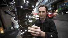 Daniel Cowan of FestiLight in Vancouver opted to take dividends instead of a salary from his startup, writing himself a bigger cheque in bumper years as a 'reward.' (Ben Nelms/The Globe and Mail)